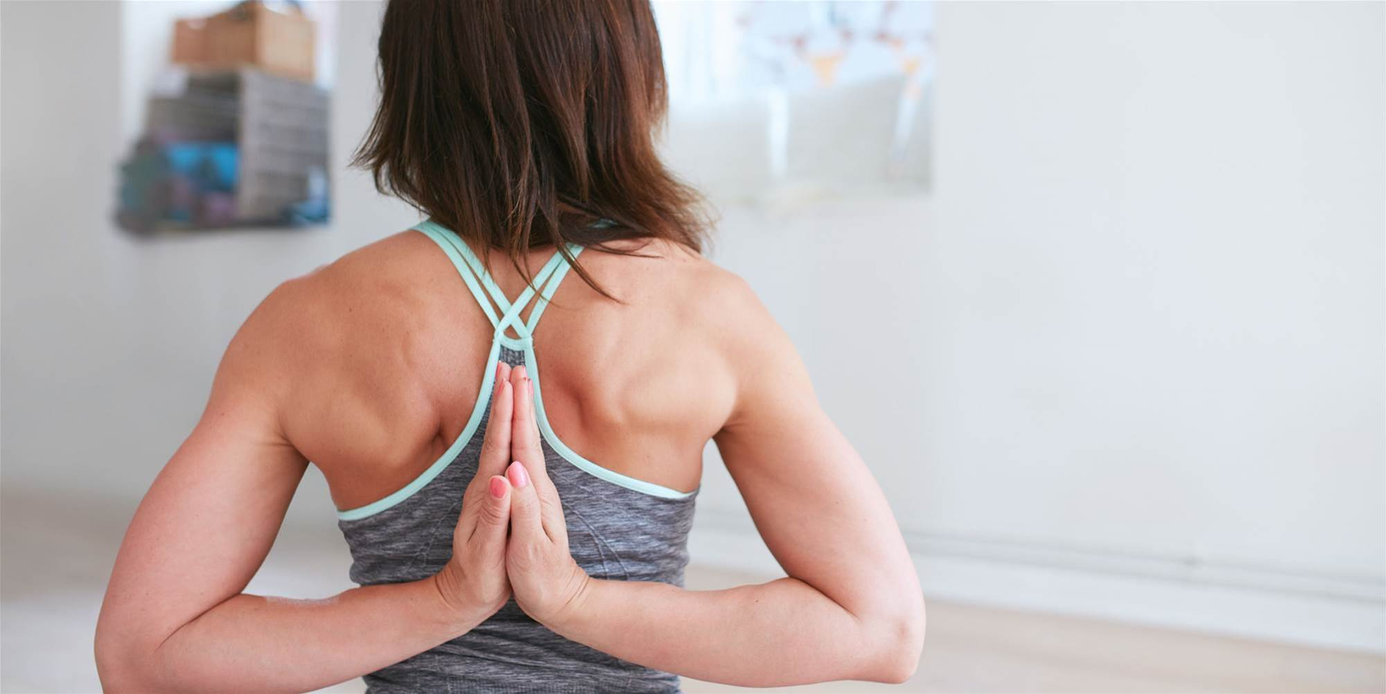 6 Yoga Shoulder Stretches to Un-Hunch Your Back and Relieve Neck Pain