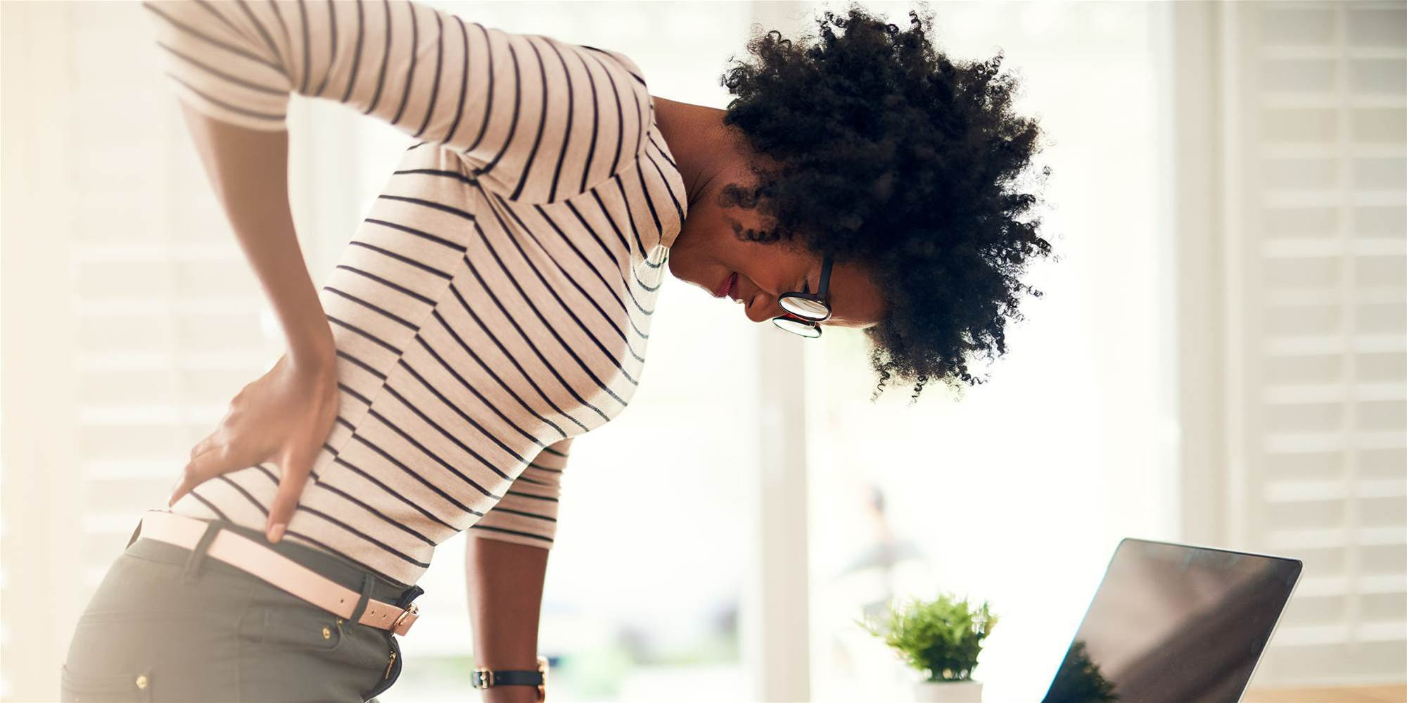 Bad Posture Isn't Why Your Back Hurts, Says This Physical Therapist