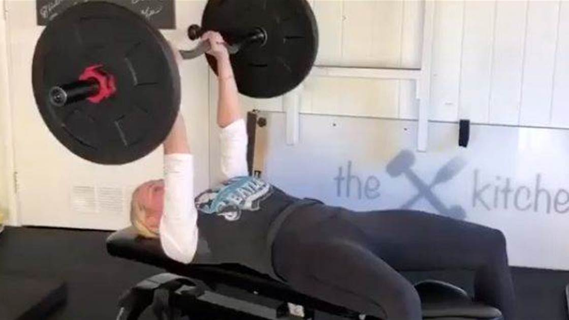 Chelsea Handler's Badass Bench Press Will Inspire You to Up Your Workout Game