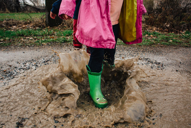 Jessica Byrum Stocksy boots in rain