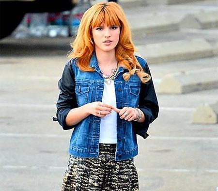 Bella Thorne pairs a denim varsity jacket with animal print shorts. Photo: Facebook
