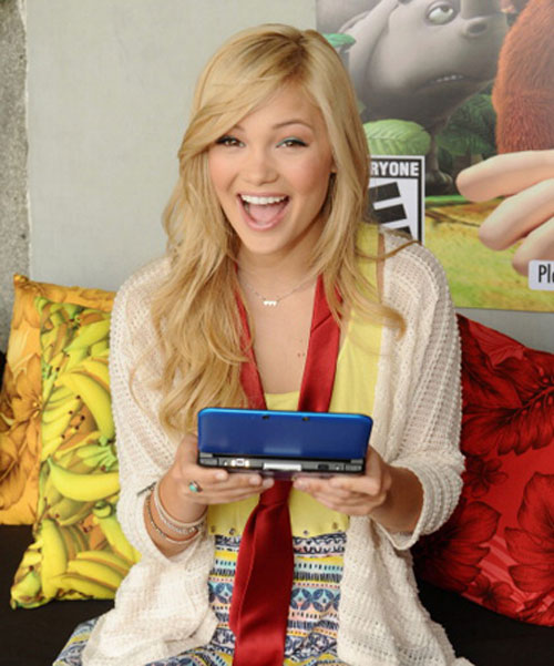 Olivia Holt plays a game console!